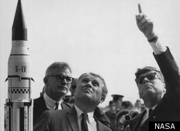 Dr. Wernher von Braun (center) describes the Saturn Launch System to President Kennedy (right, pointing). NASA Deputy Administrator Robert Seamans stands to the left of von Braun.