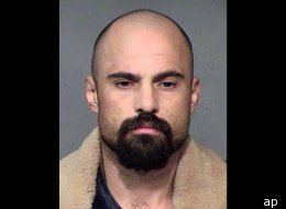 Michael Crane, accused of murdering three people, acted strangely during a court appearance.