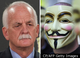A series of videos by the activist group Anonymous targeted Vic Toews in the days following his introduction of an online surveillance bill, demanding his resignation and the withdrawal of the bill or they would expose information about him. (CP/AFP Getty Images)