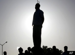 The silhouette of convicted man Mahdi Faraji is seen while he is being hanged in the city of Qazvin, about 80 miles (130 kilometers) west of the capital Tehran, Iran, Thursday, May, 26, 2011. (AP)