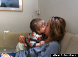 Alicia Silverstone feeding her son
