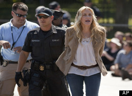 In this Aug. 30, 2011 file photo, actress Daryl Hannah is arrested by U.S. Park Police during a Keystone XL Pipeline protest in front of the White House in Washington. The high-profile anti-pipeline campaign included repeated arrests of activists outside the White House. (AP Photo/Evan Vucci, File)