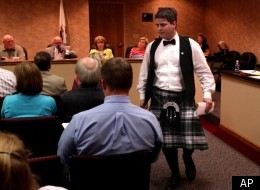 William Carruba, center, a senior at Granite City, Ill. High School, returns to his seat after asking the Community Unit 9 School Board to lift its restriction on wearing a kilt to his high school prom on Tuesday March 27, 2012. The Granite City School Board on Tuesday said no a second time to Carruba's request to wear the frock he bought made out of his family's tartan. School administrators say the kilt is nontraditional and don't fit into the district's dress code. Carruba says he understands