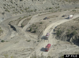 Trucks drive in the mountains of Paktika province (AP Photo/Axel Heimken)