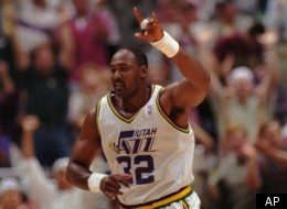 Utah Jazz Karl Malone (32) celebrates a basket in the May 30, 1996 game against the Seattle SuperSonics in Salt Lake City, Utah.