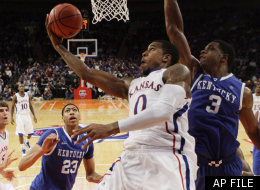 Kansas' Thomas Robinson (0) drives past Kentucky's Terrence Jones (3) during the second half of an NCAA college basketball game, Tuesday, Nov. 15, 2011, at Madison Square Garden in New York.