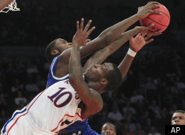 Kansas' Tyshawn Taylor (10) has his shot blocked by Kentucky's Michael Kidd-Gilchrist during the second half of an NCAA college basketball game, Tuesday, Nov. 15, 2011, at Madison Square Garden in New York. Kentucky won 75-65. (AP Photo/Frank Franklin II)