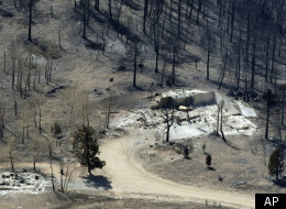 Remnants of structures are all that stand in the wake of the Lower North Fork Wildfire burning in the foothills community of Conifer, Colo., southwest of Denver on Tuesday, March 27, 2012. Firefighters are now able to actively battle the blaze on the ground that started on Monday and has already destroyed at least 16 homes in the rugged terrain. (AP Photo/David Zalubowski)