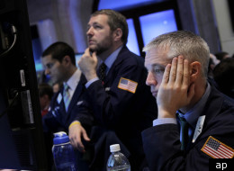 Traders on the New York Stock Exchange glumly watch the stock market selloff.