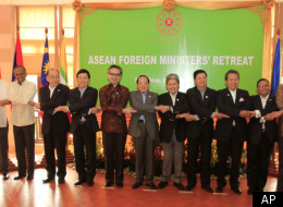 ASEAN countries' foreign ministers pose together during the ASEAN Foreign Ministers' Retreat in Siem Reap province, Cambodia, Wednesday, Jan. 11, 2012. (AP)
