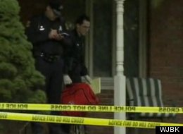 Cops investigate the scene of a grisly murder Wednesday which left a girl's new boyfriend, her mom and her killer ex-boyfriend dead.