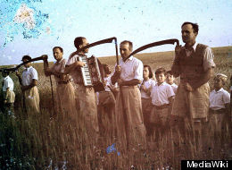 Members of Kibbutz Givat Haim Meuchad with scythes at harvest of the Omer in Israel.