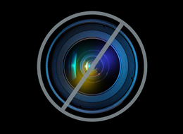 Chicago mayor Rahm Emanuel, right, visits with Brandy Toliver, left, and Mariah Neyland, in their first grade class at the CICS Washington Park School on the city's South Side Thursday, Oct. 27, 2011, in Chicago. (AP Photo/Charles Rex Arbogast)