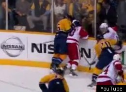 Shea Weber of Nashville slams Red Wings star Henrik Zetterberg's head into the boards.