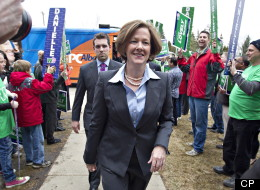Conservative leader Alison Redford walks past Wildrose leader Danielle Smith supporters as she makes her way into the Alberta Election debate in Edmonton, Alta., on Thursday April 12, 2012. THE CANADIAN PRESS/Jason Franson.