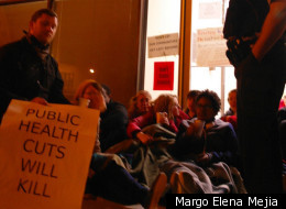 Protesters rally outside Chicago's Woodlawn Mental Health Center Thursday.