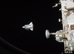 On its last flight, Discovery moves away from the International Space Station after the two spacecraft undocked.
