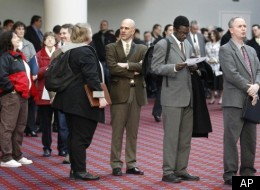In this March 7, 2012, file photo shows job seekers standing line during the Career Expo job fair, in Portland, Ore.
