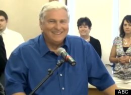 Merle Butler accepting his winnings at a press conference in Illinois Wednesday.