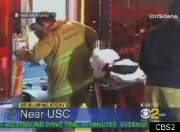 Suspect Jeremy Hendricks is being loaded into an ambulance after being shot by a USC public safety officer. (CBS2)