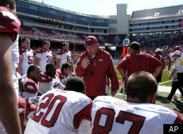 Arkansas coach Bobby Petrino, center, talks with members of the white team offense during the first half of a college intrasquad football game in Fayetteville, Ark., Saturday, April 16, 2011. (AP Photo/April L. Brown)