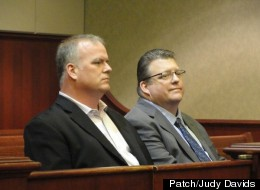 Michael Greening, right, sits in court during his arraignment on Friday, April 20, 2012 on charges of embezzlement. Credit Judy Davids