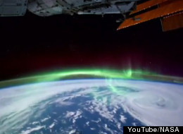 The time lapse video shows the aurora, Comet Lovejoy and city lights at night. (NASA/YouTube)