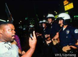 A protester confronts police during the L.A. riots in 1992.