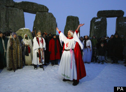 Druids take part in the winter solstice at Stonehenge in Wiltshire in the snow.