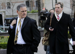 New Orleans Saints general manager Mickey Loomis, left, is followed by media as he arrives for a meeting at NFL headquarters in New York, Thursday, April 5, 2012. (AP Photo/Seth Wenig)