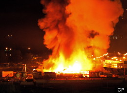 A large fire burns at the Lakeland Mills sawmill in Prince George, B.C., on Tuesday April 24, 2012. An explosion rocked the sawmill just before 10 p.m. local time setting off a fire that engulfed the facility. Full photo below. THE CANADIAN PRESS/Andrew Johnson