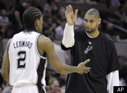 San Antonio Spurs' Tim Duncan, right, celebrates with teammate Kawhi Leonard (2) during the fourth quarter of an NBA basketball game against the Portland Trail Blazers, Monday, April 23, 2012, in San Antonio. San Antonio won 124-89, clinching the No. 1 seed in the Western Conference. (AP Photo/Eric Gay)