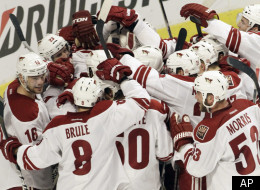 Phoenix Coyotes goalie Mike Smith (41) celebrates with teammates after the Coyotes defeated the Chicago Blackhawks 4-0 in Game 6 of an NHL hockey Stanley Cup first-round playoff series in Chicago, Monday, April 23, 2012. (AP Photo/Nam Y. Huh)