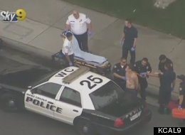 West Covina, CA police apprehend a man suspected of robbing the First Federal Credit Union.
