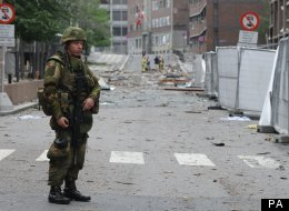 A soldier stands guard at the site of the attack in Oslo, Norway, 23 July 2011.