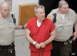 Former Bolingbrook, Ill., police sergeant Drew Peterson leaves the Will County Courthouse in Joliet, Ill., Friday, May 8, 2009, after his arraignment on charges of first-degree murder in the 2004 death of his former wife Kathleen Savio, who was found in an empty bathtub at home. (AP Photo/M. Spencer Green)