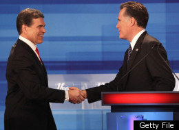 Republican presidential candidates Texas Gov. Rick Perry (L) and former Massachusetts Gov. Mitt Romney chat following the Fox News Channel debate at the Sioux City Convention Center on December 15, 2011 in Sioux City, Iowa.