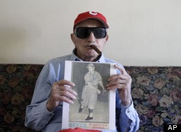 Cuban former pitcher Conrado Marrero, who once played with the Washington Senators, shows a photography of him on an old newspaper as he speaks during an interview in Havana, Cuba, Wednesday, April 25, 2012. Marrero, who last year became the oldest living former big leaguer, turned 101 on Wednesday. (AP Photo/Franklin Reyes)