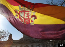 Standard & Poor's lowered Spain's long-term credit rating by two notches on Thursday, saying the country's budget problems are likely to get worse because of the weak economy.