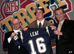 Ryan Leaf, center, of Washington State gets help holding up his San Diego Chargers jersey by Chargers owner Alex Spanos, left, and NFL commissioner Paul Tagliabue as the second pick overall in the 1998 NFL Draft.