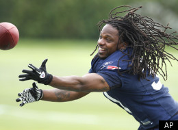 New England Patriots safety Brandon Meriweather reaches for the football during the NFL team's training camp in Foxborough, Mass., Thursday, July 28, 2011. (AP Photo/Charles Krupa)