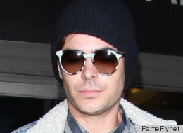 Zac Efron returns to Los Angeles after promoting his new movie,