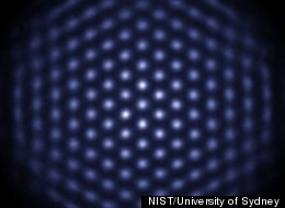 In this photo of the ion-crystal device, each blue dot represents an atom.