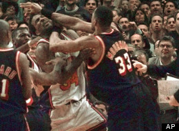 Knicks-Heat Rivalry: Miami Heat's Alonzo Mourning, right, and New York Knicks' Charles Oakley grapple as Knicks coach Jeff Van Gundy holds on, April 30, 1998.