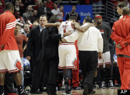 Chicago Bulls guard Derrick Rose (1) is helped off the court after an injury during the fourth quarter of  Game 1 in the first round of the NBA playoffs against the Philadelphia 76ers, April 28, 2012.