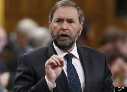 NDP Leader Tom Mulcair isn't saying how much the NDP was forced to pay back after Elections Canada found they violated political financing laws.