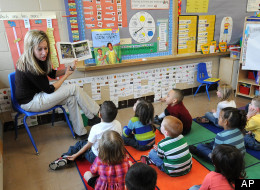 Angie Clark, a preschool teacher, reads to a group of four and five year old students, at Mitchell Elementary School, Tuesday March 29, 2011, in Des Moines, Iowa. (AP Photo/Steve Pope)