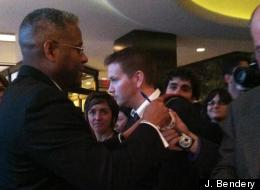 Rep. Allen West (R-Fla.) autographs a baseball for a fan kept away from the festivities during Saturday night's White House Correspondents Association dinner.