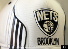 A hat bearing the new logo of the Brooklyn Nets is displayed during a news conference to unveil the new logos of the Brooklyn Nets in New York, Monday, April 30, 2012. The Nets will be moving from New Jersey to the new Barclays Center in Brooklyn, New York for the 2012-2013 NBA basketball season. (AP Photo/Seth Wenig)