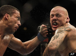 In this Aug. 27, 2011 file photo, Brazil's Edson Barboza, left, punches Ross Pearson of England during their lightweight 'swing' mixed martial arts bout at the Ultimate Fighting Championship (UFC) 134 in Rio de Janeiro, Brazil. Pearson was arrested on was arrested on suspicion of DUI this weekend in Las Vegas